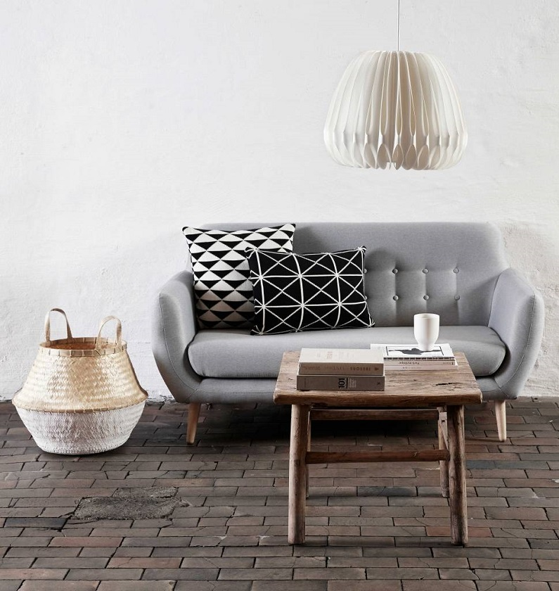 brown modern coffee table with coffee cup and  books