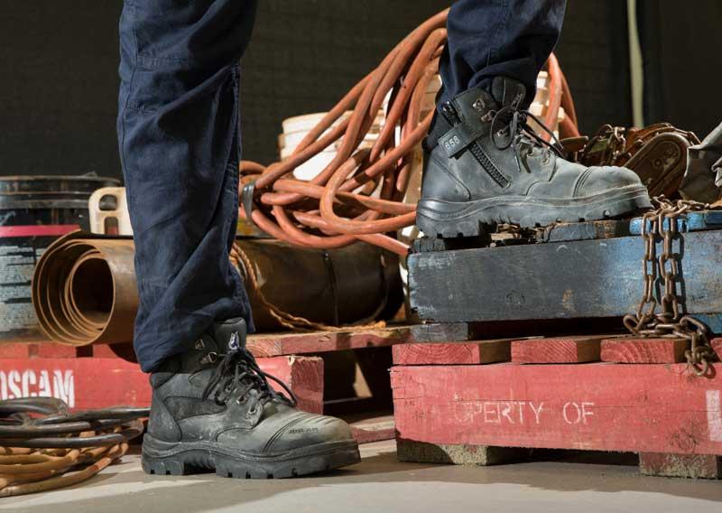 worker wearing steel toe boots