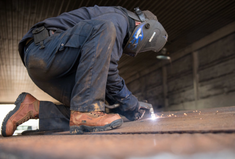 worker with steel toe boots