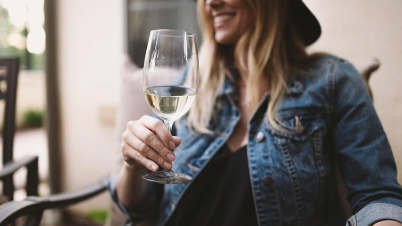 woman drinking vegan white wine