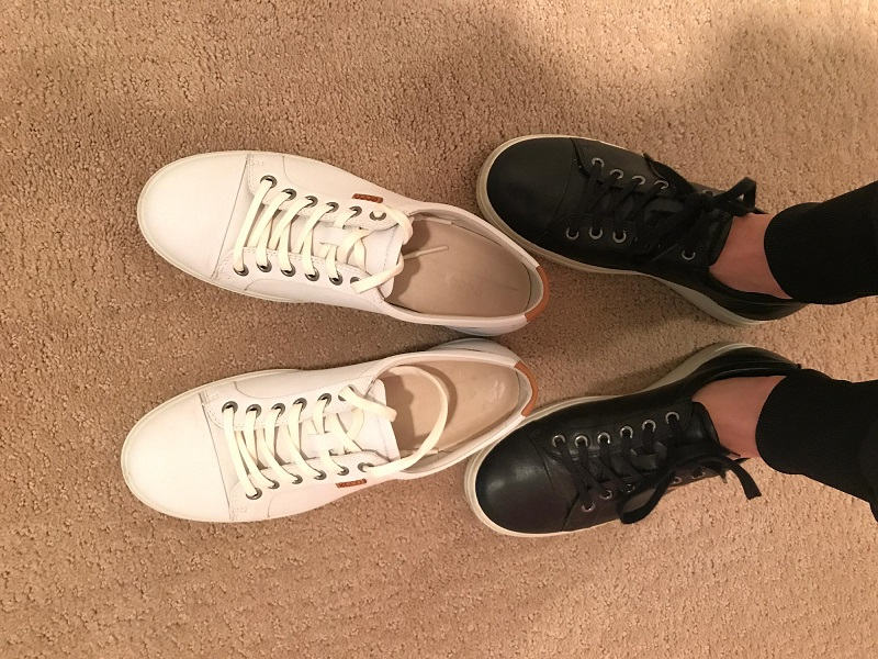 picture of a black and white flat lace up shoes