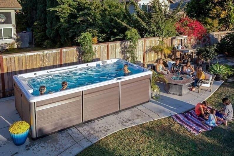 family swimming in swim spas
