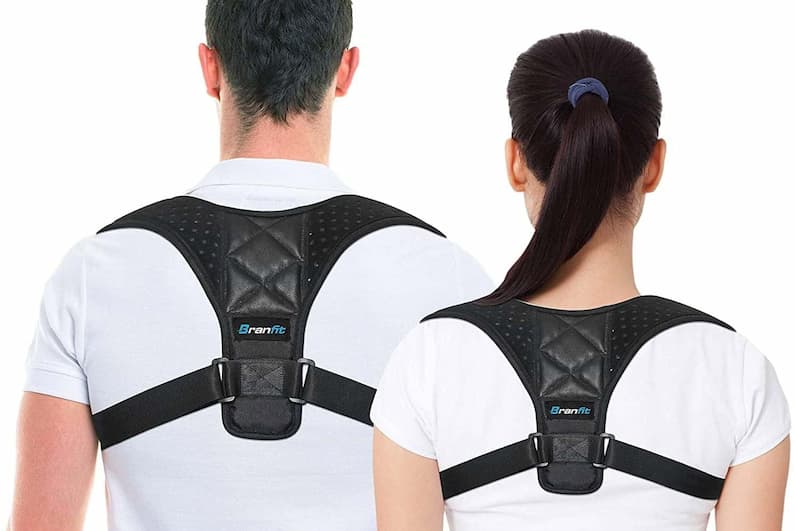 man and a woman with posture brace
