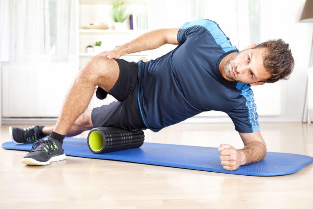 man exercising on a foam roller