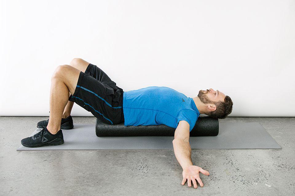 man relaxing on a foam roller